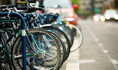 bicycle parked street side in down town neighborhood
